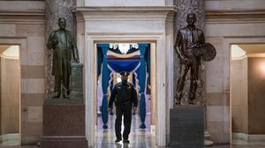 A US Capitol Police officer patrols the area near the House of Representatives chamber (J. Scott Applewhite/AP)