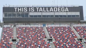 Empty stands are part of the scene prior to the start of the Nascar race in Talladega (John Bazemore/AP)