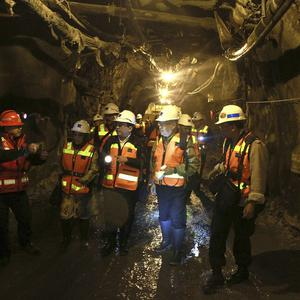 Rescuers recovered four more bodies from a collapsed underground room at a mine in Indonesia, bringing the confirmed death total to 15 (AP)