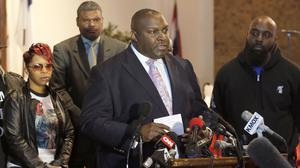 Lawyer Daryl Parks talks to reporters as Lesley McSpadden and Michael Brown Sr listen during a news conference (AP)