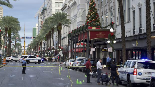 New Orleans police investigate the scene of the shooting (Max Becherer/The Advocate/AP)