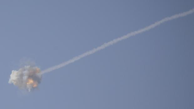 An Israeli Iron Dome air defence system missile is seen intercepting rockets fired from Gaza (Ariel Schalit/AP)