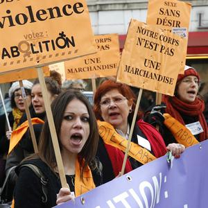 People demonstrate against prostitution outside the parliament in Paris (AP)