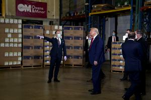 Donald Trump, again ignoring recommendations to wear a face mask, tours Owens and Minor Inc., a medical supply company in Allentown, Pennsylvania (Evan Vucci/AP)