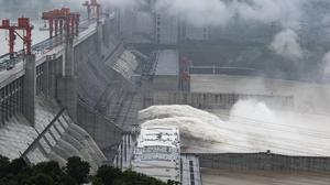 Water flows out from sluiceways at the Three Gorges Dam on the Yangtze River near Yichang (Zheng Jiayu/Xinhua via AP)