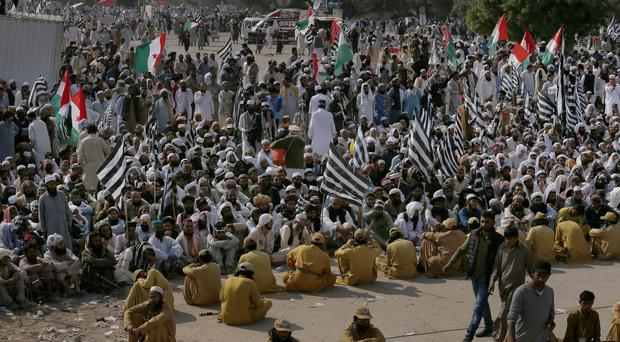 Supporters of the Jamiat Ulema-e-Islam party during an anti-government march in Islamabad (Anjum Naveed/AP)