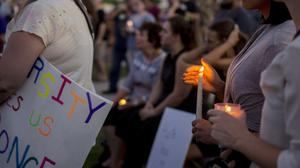 Candles are held during a vigil for victims in Charlottesville (AP)