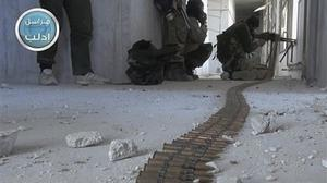 Fighters from Syria's al Qaida-linked Nusra Front take their positions as they fight against the Syrian government forces in Idlib province (AP/Nusra Front)