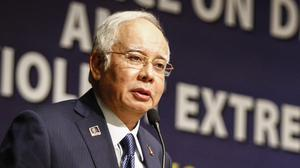 Prime minister Najib Razak was under pressure to resign over the financial scandal (AP)
