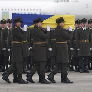 Honour guards carry the coffin of one of 11 victims at Borispil international airport outside Kyiv (Ukrainian Presidential Press Office via AP)