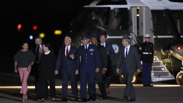 Vice President Mike Pence, fourth from left, accompanied by his wife Karen Pence, third from left, and others arrive to greet the former North Korean detainees (AP)