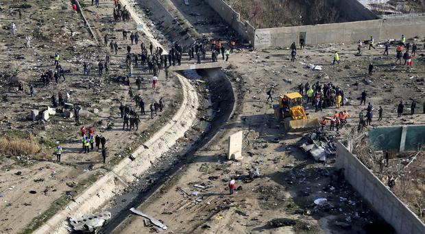 Iran president calls for special court to probe plane crash