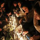 Candlelit vigil to remember the victims of the Ukraine plane crash in Tehran, Iran (Ebrahim Noroozi/AP)