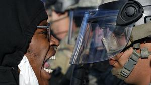 Protesters and National Guardsmen face off during one of many protests across the US (John Minchillo/AP)