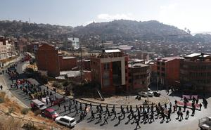 Demonstrators protest against the government's response to the pandemic in La Paz, Bolivia (Juan Karita/AP)