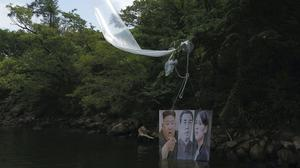 A balloon carrying a banner with images of North Korean leaders released by Fighters For Free North Korea in Hongcheon, South Korea (Yonhap via AP)