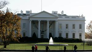 Two US Secret Service agents are accused of crashing a car into a White House security barrier