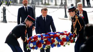 President Emmanuel Macron lays a wreath of flowers during a ceremony to mark the 75th anniversary of VE Day (Charles Platiau/Pool via AP)
