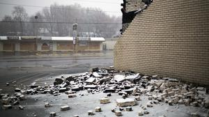 Freshly fallen snow covers bricks from a burned down beauty store and office building in Ferguson (AP)