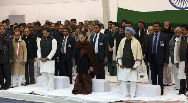 India's main opposition Congress party leader Rahul Gandhi, party president Sonia Gandhi and former prime minister Manmohan Singh stand during a silent protest against a new citizenship law (AP)