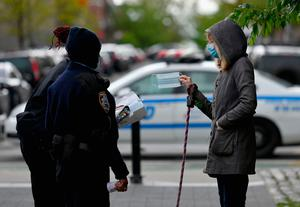 NYPD officers hand out face masks in the Brooklyn borough of New York