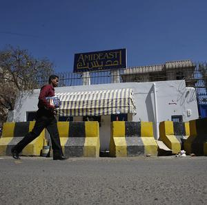 A student walks by Amideast, an American institute where a British teacher used to teach before he was kidnapped in Sanaa (AP)