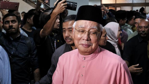 Malaysia's former Prime Minister Najib Razak has been barred from leaving the country (Sadiq Asyraf/AP)