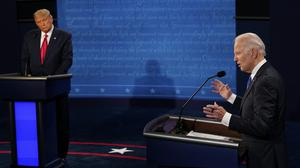 President Donald Trump and Democratic presidential candidate former vice president Joe Biden participate in the final presidential debate at Belmont University in Nashville, Tennessee (Jim Bourg/Pool via AP)