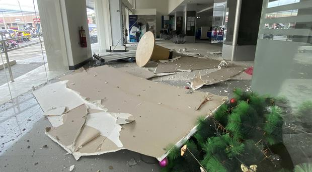 Debris on the ground inside a building after a strong earthquake shook Digos, Davao del Sur province, southern Philippines (Philippine Red Cross via AP)