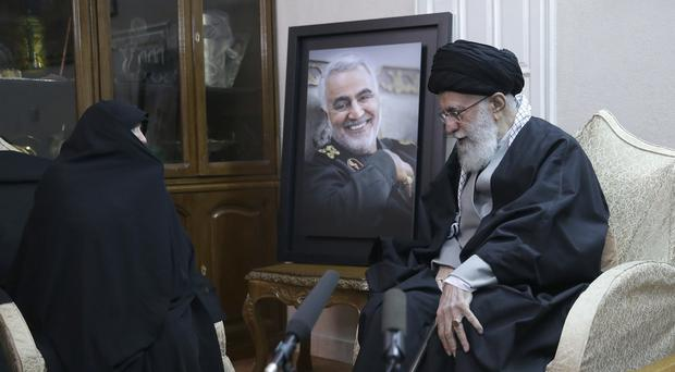 In this picture released by the official website of the office of the Iranian supreme leader, Supreme Leader Ayatollah Ali Khamenei, right, meets family of Iranian Revolutionary Guard Gen. Qassem Soleimani, who was killed in the US airstrike in Iraq (AP)