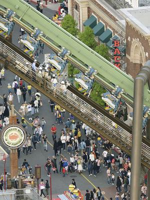 Passengers are rescued from the stopped Flying Dinosaur rollercoaster at Universal Studios Japan (Kyodo News/AP)