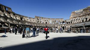 Members of the media walk inside the ancient Colosseum during a press preview for the reopening of the museum, in Rome (Cecilia Fabiano/LaPresse/AP)