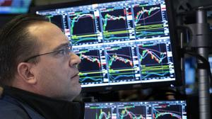 A stock trader works at the New York Stock Exchange (AP)