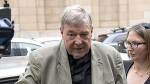 File photo of Cardinal George Pell leaving court (Andy Brownbill/AP)