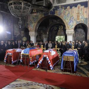 The coffins of King Petar II Karadjordjevic, second from left, his wife, mother and brother are seen during the funeral ceremony in Serbia (AP)