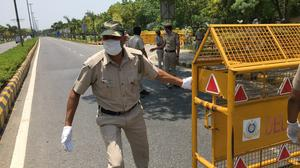 Policemen barricade the road outside the Chinese embassy in New Delhi, India, Wednesday, June 17, 2020. As some commentators clamored for revenge, India's government was silent Wednesday on the fallout from clashes with China's army in a disputed border area in the high Himalayas that the Indian army said claimed 20 soldiers' lives. An official Communist Party newspaper said the clash occurred because India misjudged the Chinese army's strength and willingness to respond. The Global Times, which often reflects nationalistic views within the party's leadership, said China did not disclose whether it had casualties in the skirmish to avoid comparisons and prevent further escalation. (AP Photo/Shonal Ganguly)