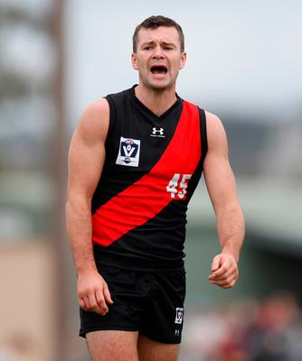 Conor McKenna playing for Essendon