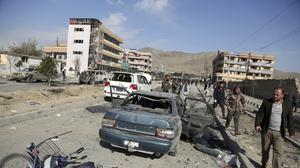 Afghan security personnel at the site of a car bomb attack in Kabul (Rahmat Gul/AP)