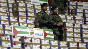 Soldiers guard electoral kits to be recounted in Quito, Ecuador (AP)