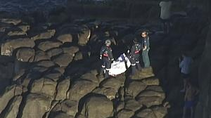 The man's body is placed on a cliff near Indian Head (AuBC/CHANNEL 7/CHANNEL 9 via AP)