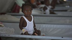 A girl receives treatment for cholera symptoms at a Doctors Without Borders cholera clinic in Port-au-Prince, Haiti (AP)