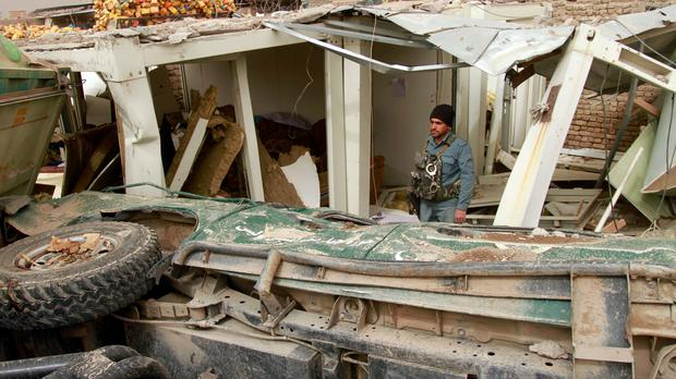 A security official inspects the site of a car bomb attack in Herat province, west of Kabul, Afghanistan (Hamed Sarfarazi/AP)