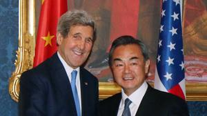 US secretary of state John Kerry and Chinese foreign minister Wang Yi meet ahead of nuclear talks with Iran (AP)