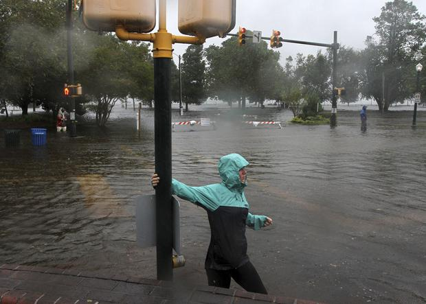 Hurricane Florence already has inundated coastal streets with ocean water and left tens of thousands without power (Gray Whitley/Sun Journal via AP)