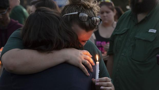 People embrace during a vigil held in the wake of a deadly school shooting with multiple fatalities at Santa Fe High School (Stuart Villanueva/AP)