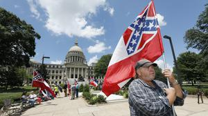 Mississippi's state flag features a confederate emblem (AP/Rogelio V. Solis)