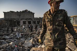 Azerbaijani soldiers and firefighters look for survivors (AP)