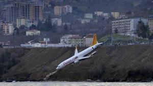 A Pegasus Airlines Boeing 737-800 after skidding off the runway downhill towards the sea at the airport in Trabzon (DHA-Depo Photos via AP)