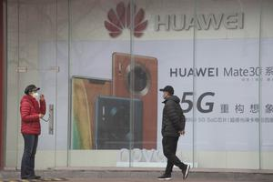 "China's commerce ministry says it will take ""all necessary measures"" in response to new US restrictions on Chinese tech giant Huawei's ability to use American technology (Ng Han Guan/AP)"