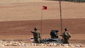 Turkish soldiers overlook the fighting positions between Syrian Kurds and Islamic State militants. (AP)